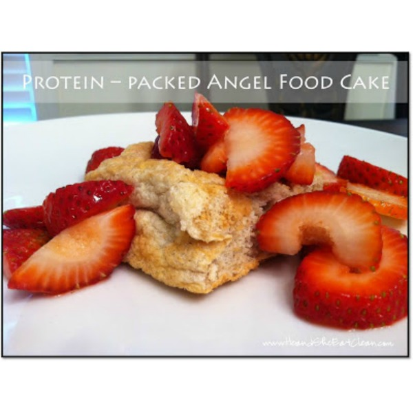 angel food cake with strawberries on a white plate