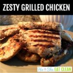 grilled chicken stacked on top of a beige plate with text that reads zesty grilled chicken square image