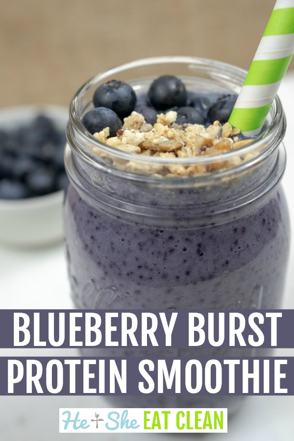blueberry protein shake in a glass mason jar with blueberries and granola on top