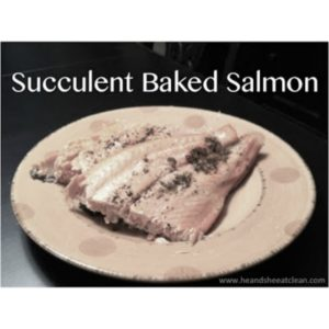 salmon on a plate with text that reads succulent baked salmon