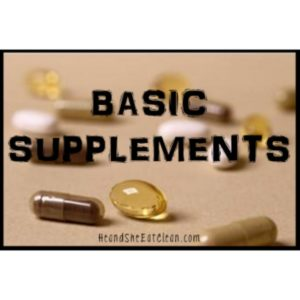 pills on a beige mat with text that reads basic supplements