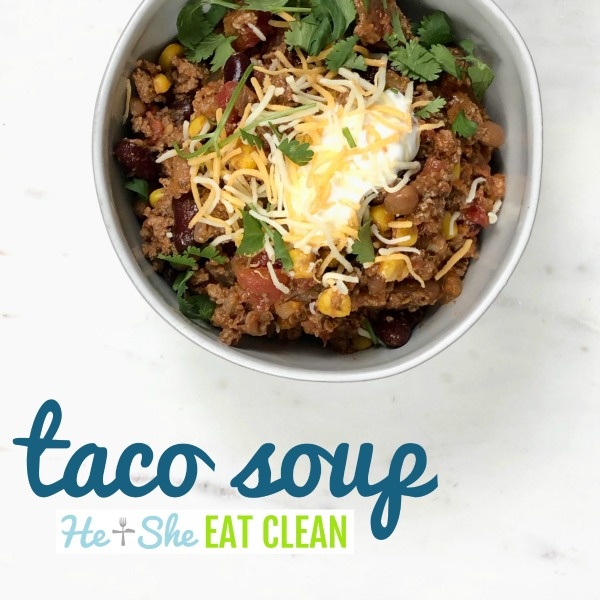 bowl of taco soup with cilantro, greek yogurt, and cheese on top square image