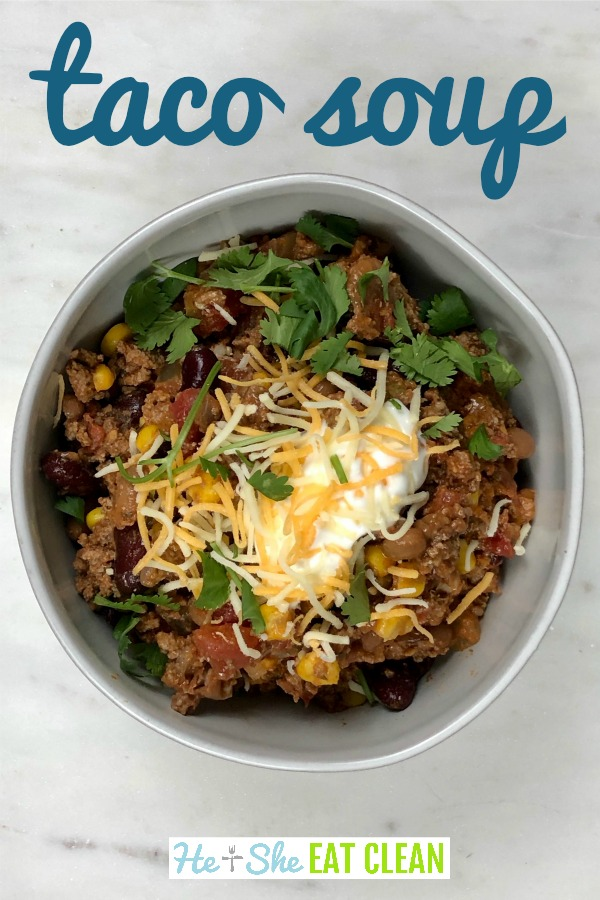 bowl of taco soup with cilantro, greek yogurt, and cheese on top