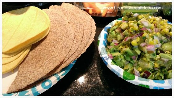 two paper plates, one with tortilla and one with guacamole
