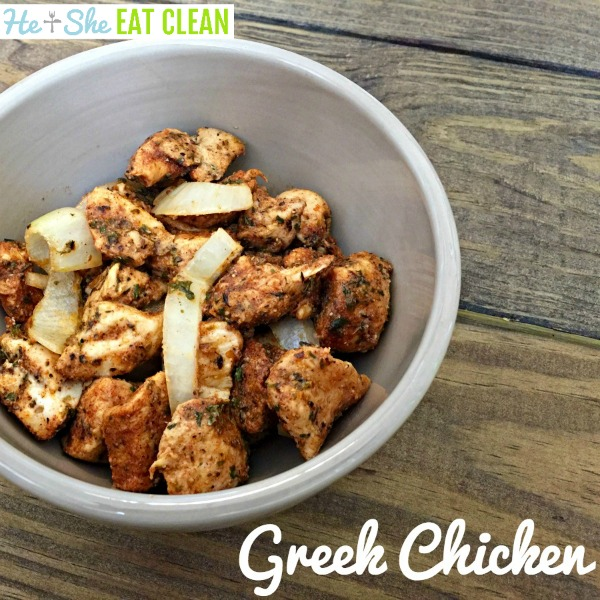 Greek chicken nuggets in a beige bowl on a wooden table