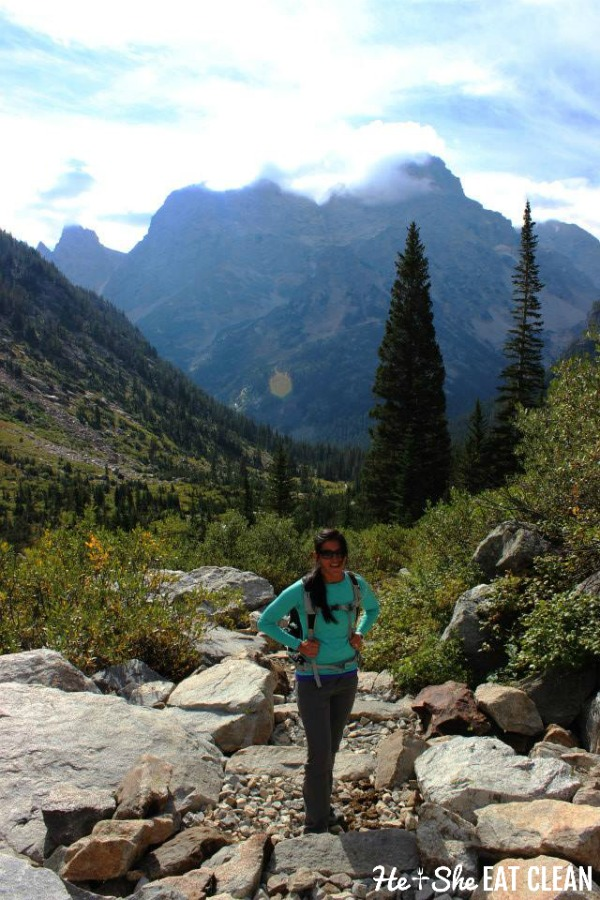 female standing in front of Grand Teton