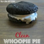 whoopie pie cookie with white frosting in the middle on a wooden table