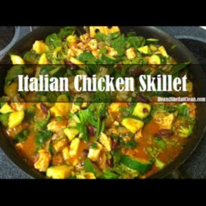pan of chicken and vegetables with text that reads Italian Chicken Skillet