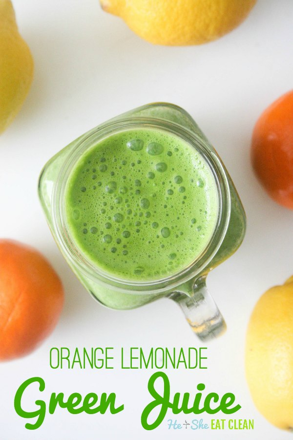 green juice in a clear glass with oranges and lemons on a white tabletop with text that reads orange lemonade green juice