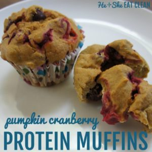 square image of two pumpkin cranberry muffins on a white plate with text that reads pumpkin cranberry protein muffins