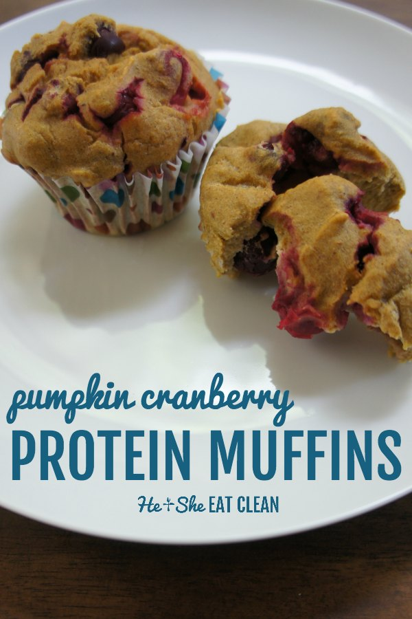 two pumpkin cranberry muffins on a white plate with text that reads pumpkin cranberry protein muffins