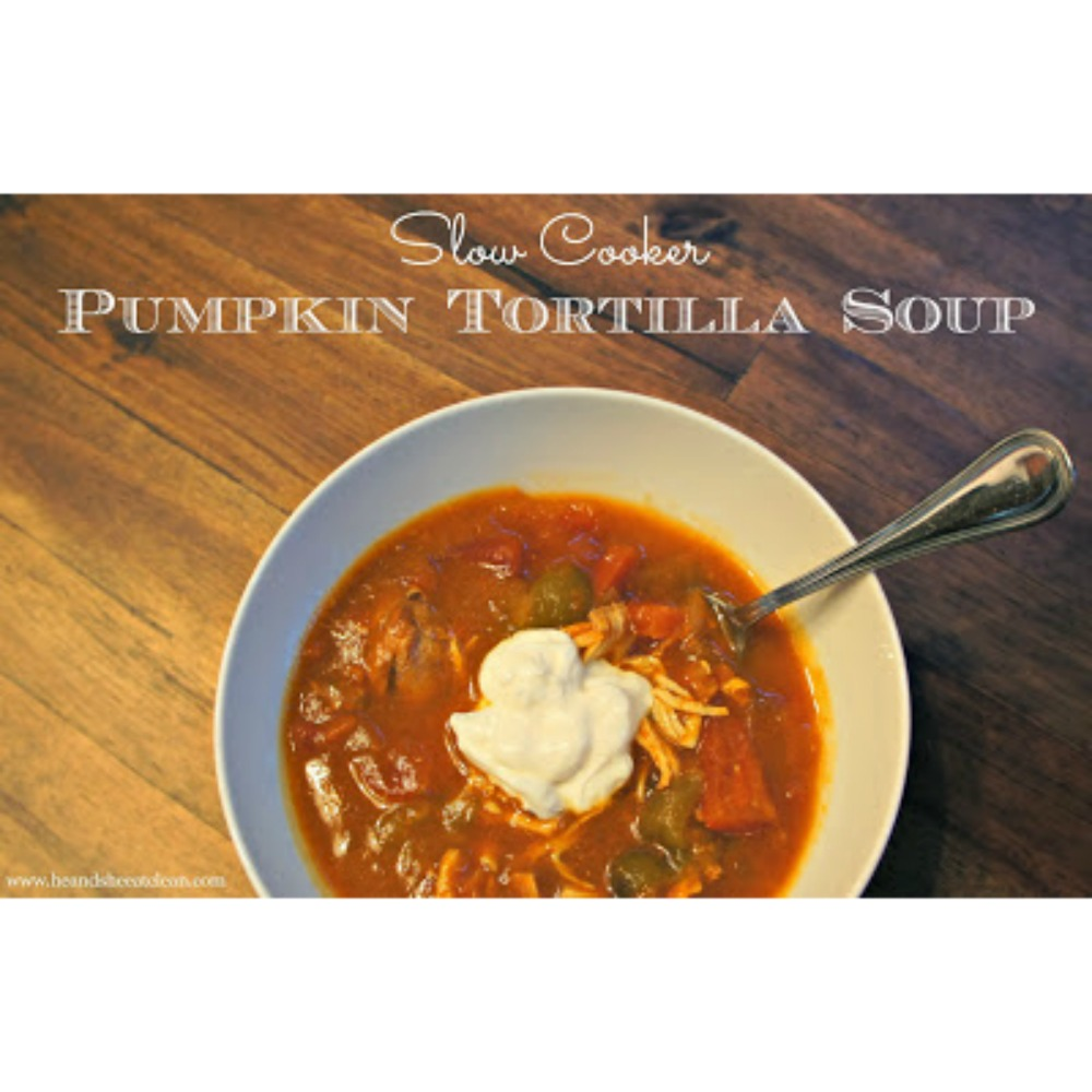 Pumpkin Tortilla Soup in a white bowl on a wooden table