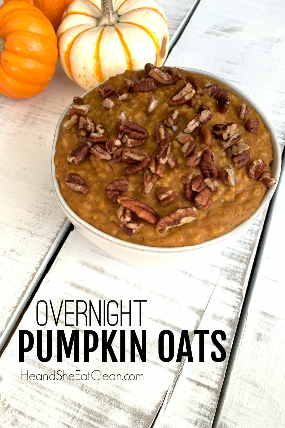 white bowl full of pumpkin oats with pecans on top on a white tabletop