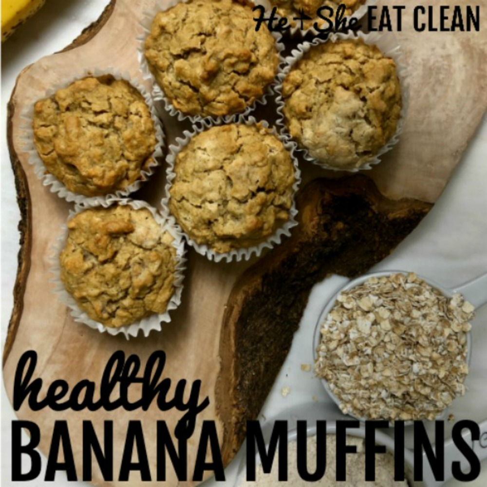 6 banana muffins on a wooden board with bananas in the background and oats and oat flour to the side - clean eating