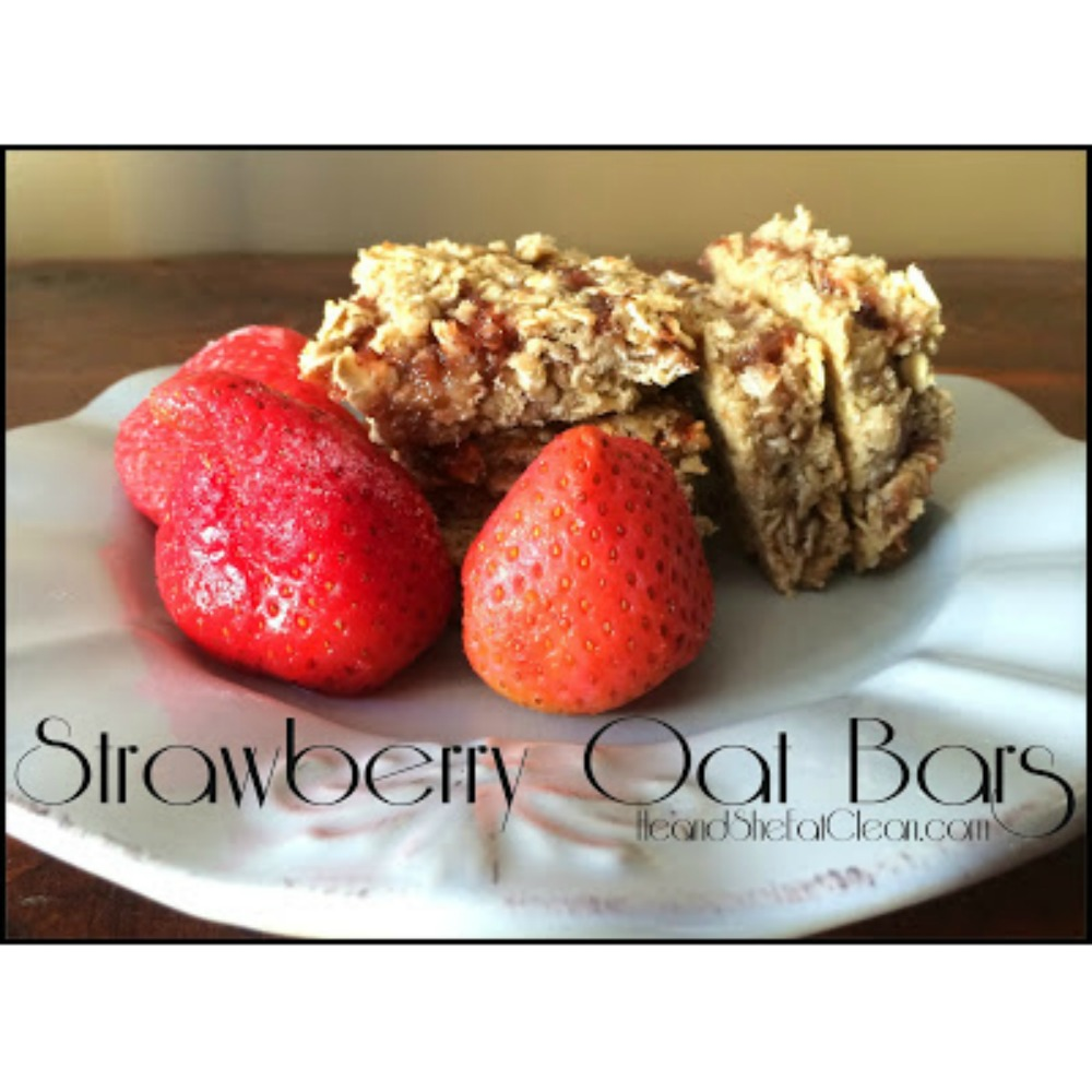 Strawberry Oat Bars on a white plate with strawberries