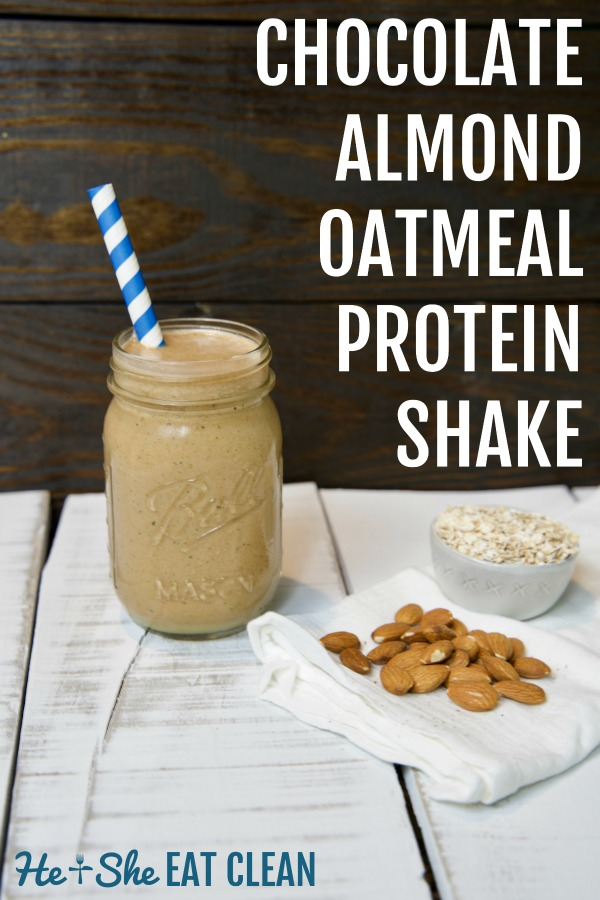 almond protein shake in a glass mason jar with a blue straw on a white wooden plank board