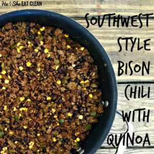 bison chili with corn in a black pot on a wooden table