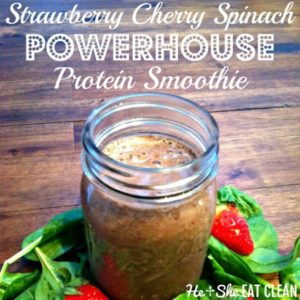 Strawberry Cherry Spinach Powerhouse Smoothie in a mason jar on a wooden table