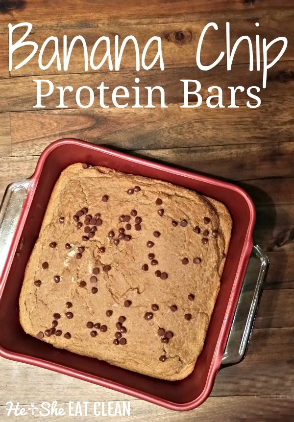 pan of protein bars with chocolate chips in a red pan on a wooden table with text that reads banana chip protein bars
