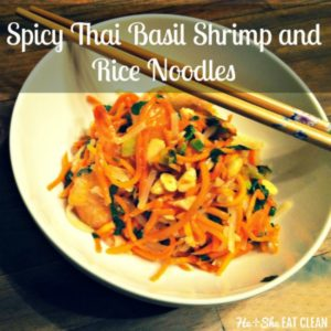 spicy thai basil shrimp and rice noodles in a white bowl with two wooden chopsticks on top
