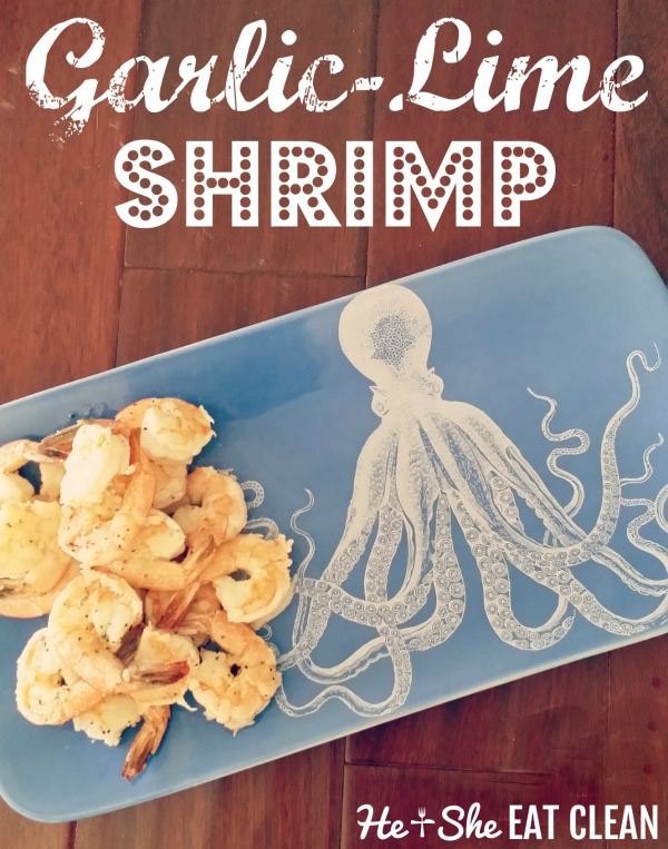 shrimp on a blue platter with a painted octopus on a wooden table