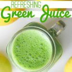 green juice in a clear glass with lemons on a white tabletop with text that reads refreshing green juice square image