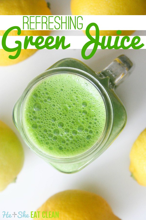 clear glass with green juice on a white counter with lemons