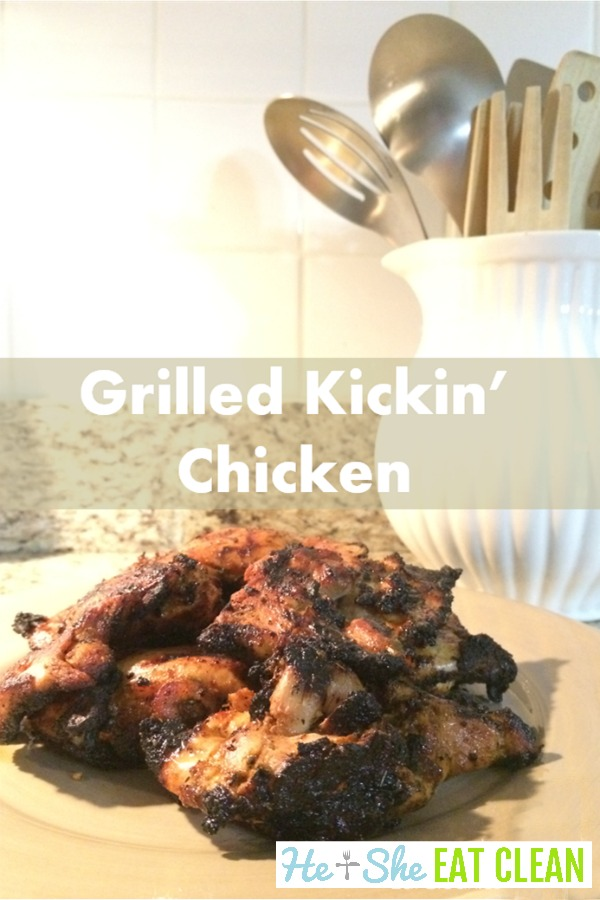 grilled chicken thighs piled on a beige plate with text that reads grilled kickin chicken