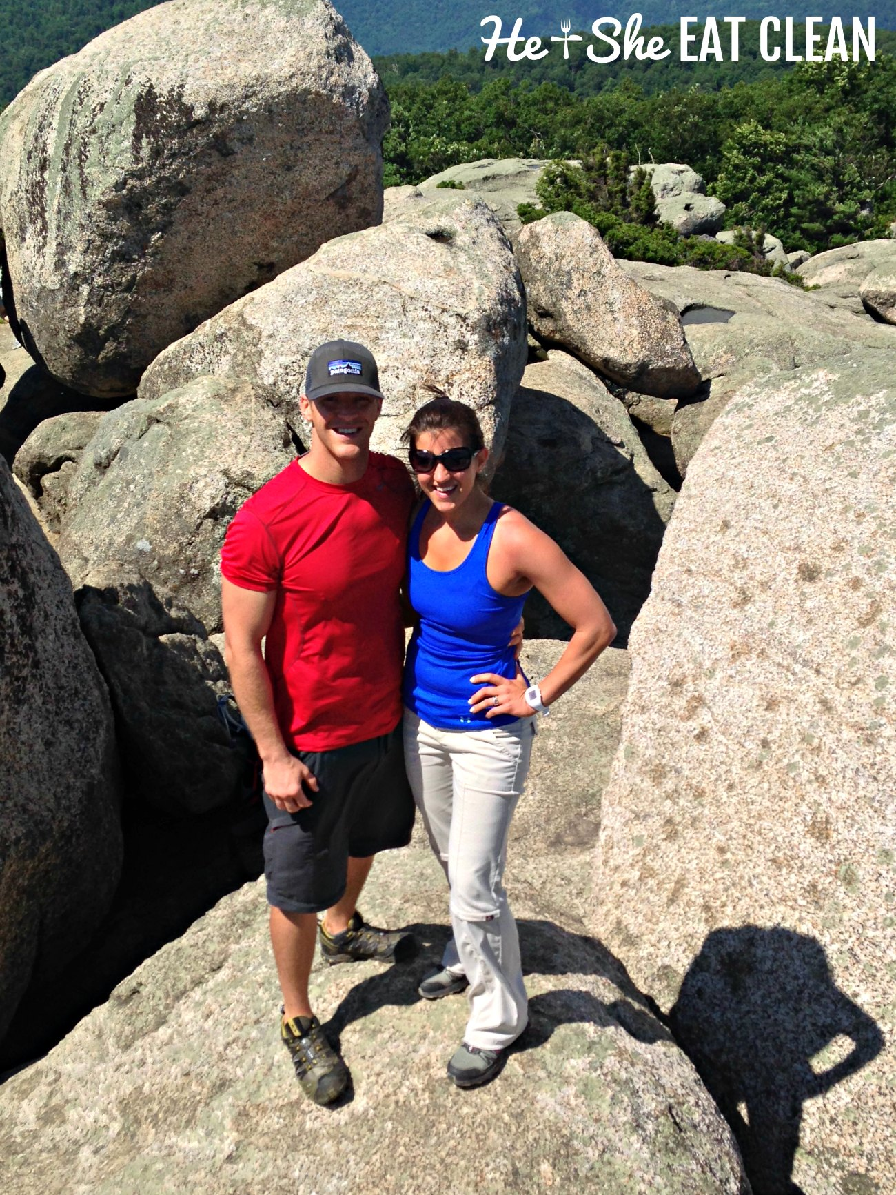 male and female standing near rocks on a hiking trail - Old Rag Mountain in Shenandoah National Park