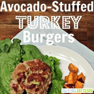 avocado-stuffed turkey burgers with lettuce and sweet potato cubes on a white plate square image
