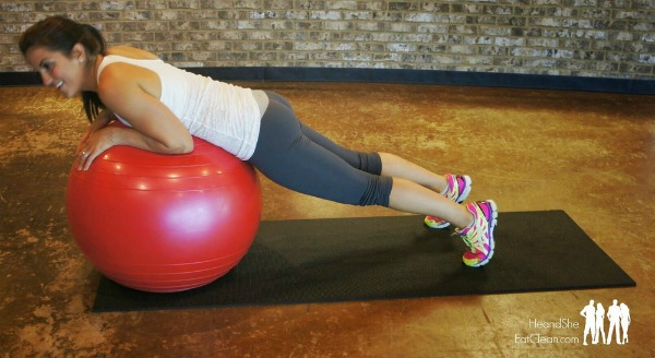 female on a pink exercise ball