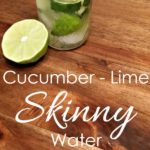 lime and cucumber in a water glass on a wooden table with text that reads cucumber lime skinny water square image
