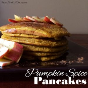 stack of pumpkin pancakes with apples sliced on top
