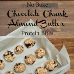 chocolate chunk bites on a pan lined with parchment paper with text that reads no bake chocolate chunk almond butter protein bites square image
