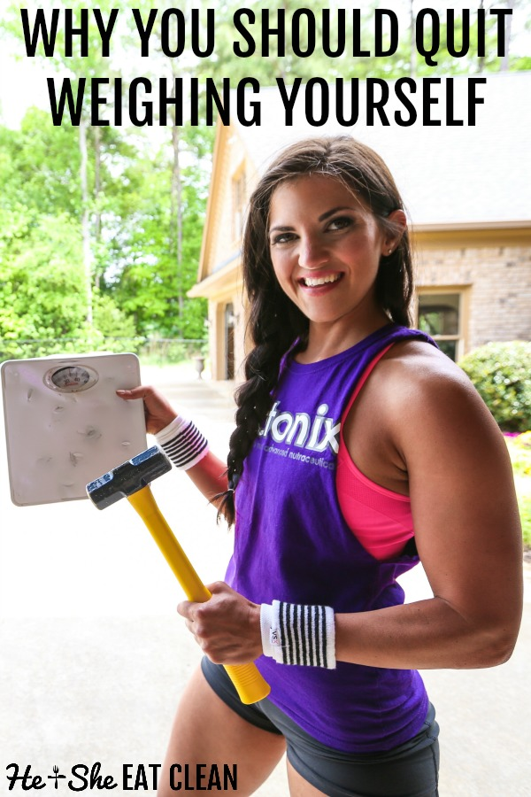 female in purple tank holding a hammer and weight scale