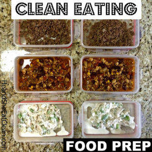 6 different containers with food prepped on a granite countertop. Text reads Clean Eating Food Prep
