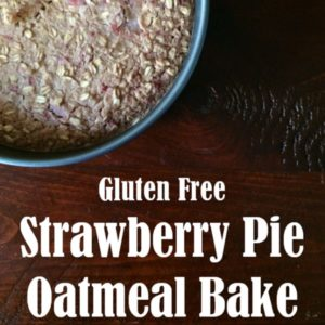 strawberry pie oatmeal bake in a silver pan on a wooden table square image
