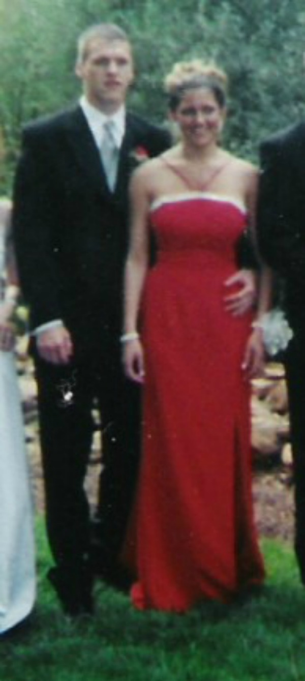 male in a tux and female in a red dress before prom 2001