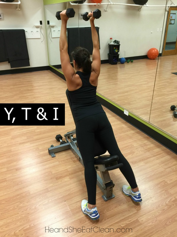 female doing Y, T & I Shoulder Exercise in a gym