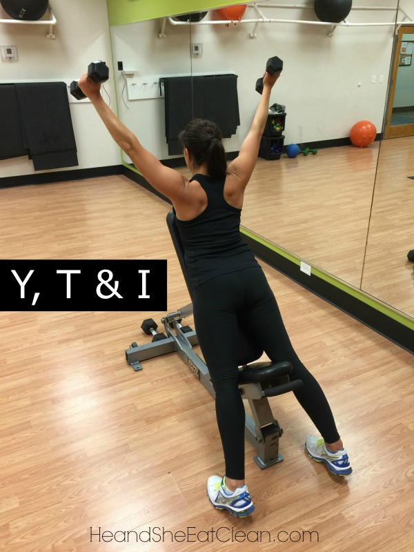 "female doing Y, T & I Shoulder Exercise in a gym - the ""Y"" portion"