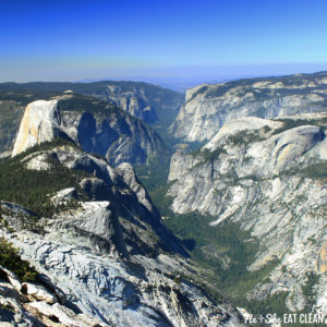 view of Half Dome in Yosemite National Park: granite mountains with blue sky