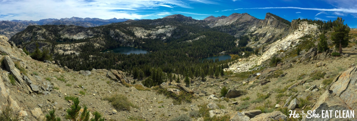 mountains with blue sky and two lakes: panoramic view of Ten Lakes Basin (center) and the Sierra Crest (far left)
