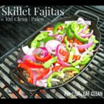skillet fajitas with peppers and onions on top on a grill