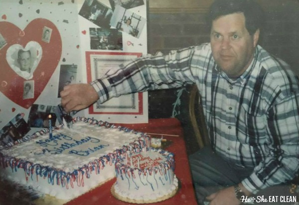 man cutting a cake