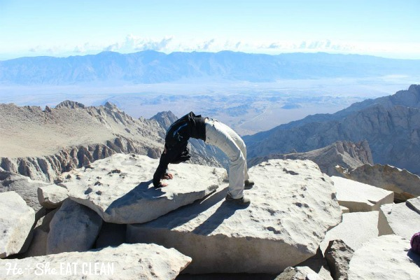 female doing a backbend at the top of Mount Whitney in California