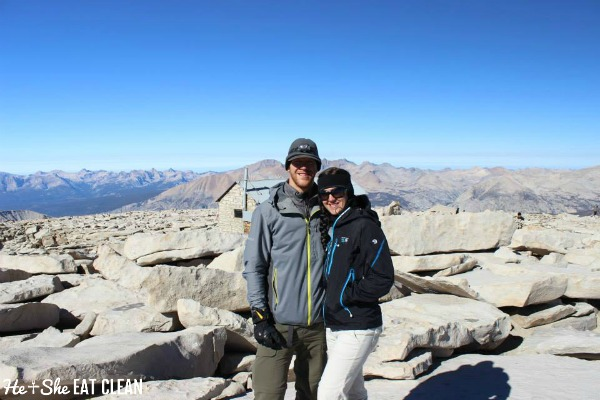 male and female standing at the top of Mount Whitney in California