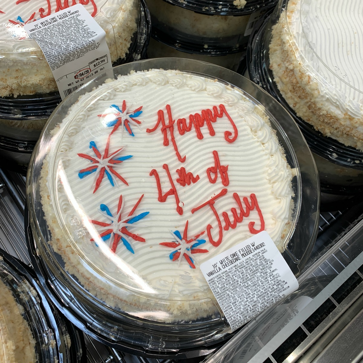 white cake from Costco that reads Happy 4th of July with fireworks