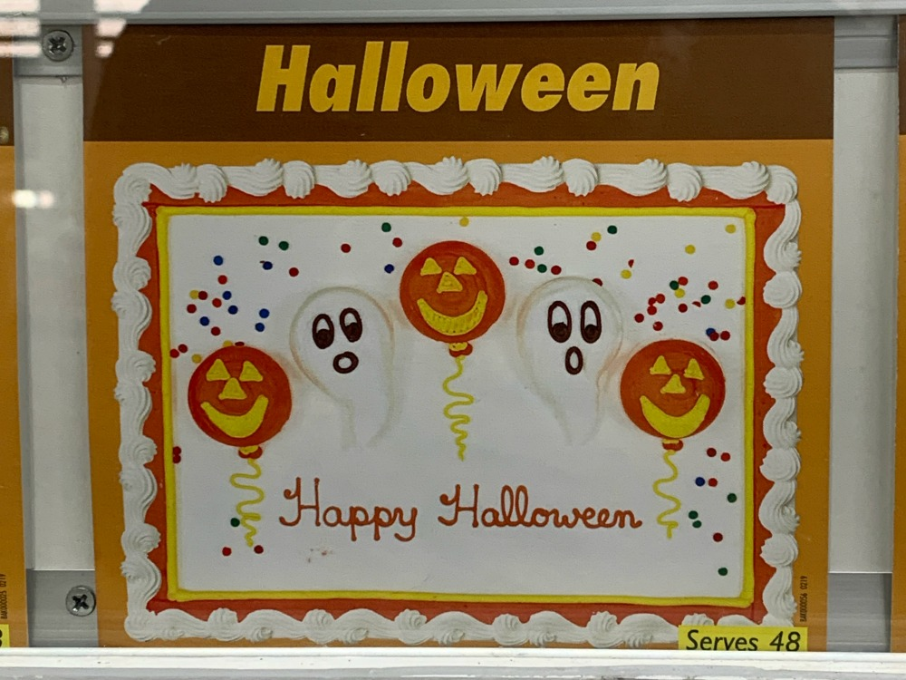 Costco Cake: white frosting, text reads Happy Halloween with pumpkins and ghosts