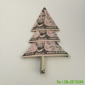 folded dollar bills made into the shape of a Christmas tree