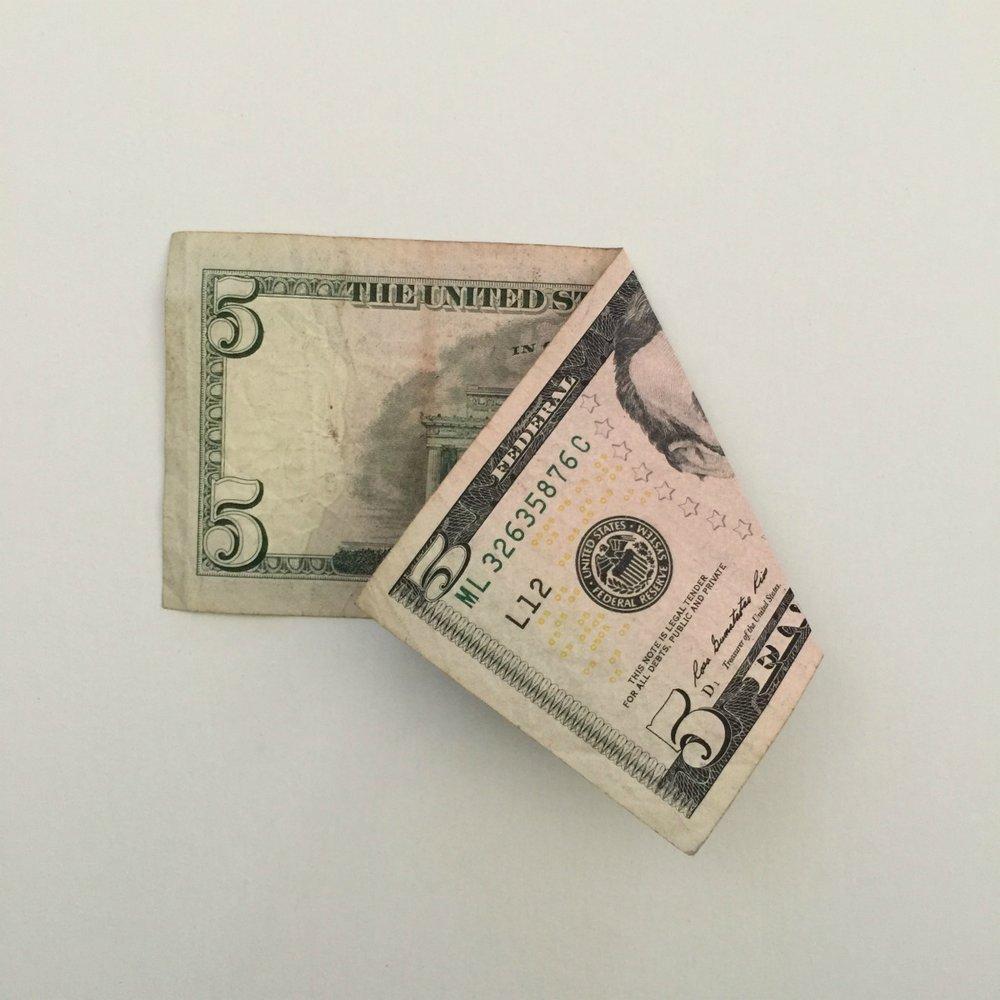5 dollar bill folded to make Christmas money tree
